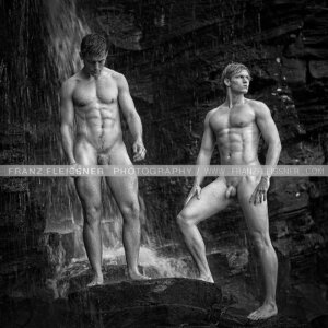 Handsome shirtless young male models  in waterfall