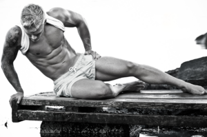 shirtless athletic man  by Franz Fleissner, Photography