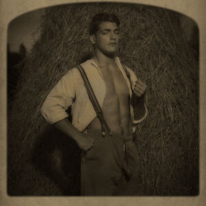 Man standing next to a haystack